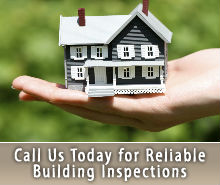 Little house in the hand of a home inspector
